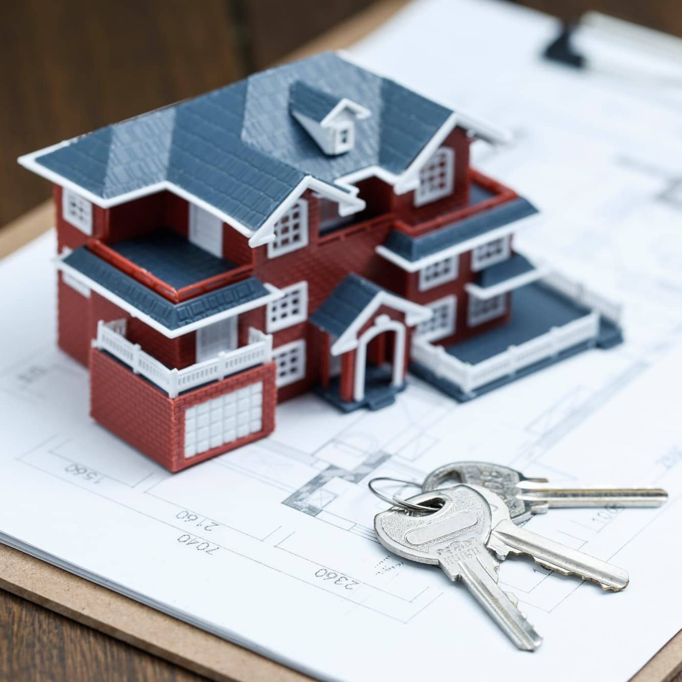 villa-house-model-key-drawing-retro-desktop-real-estate-sale-concept